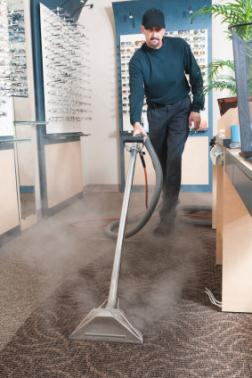 Manny's Carpet Cleaning cleaning carpet via hot water extraction in Ruskin FL.
